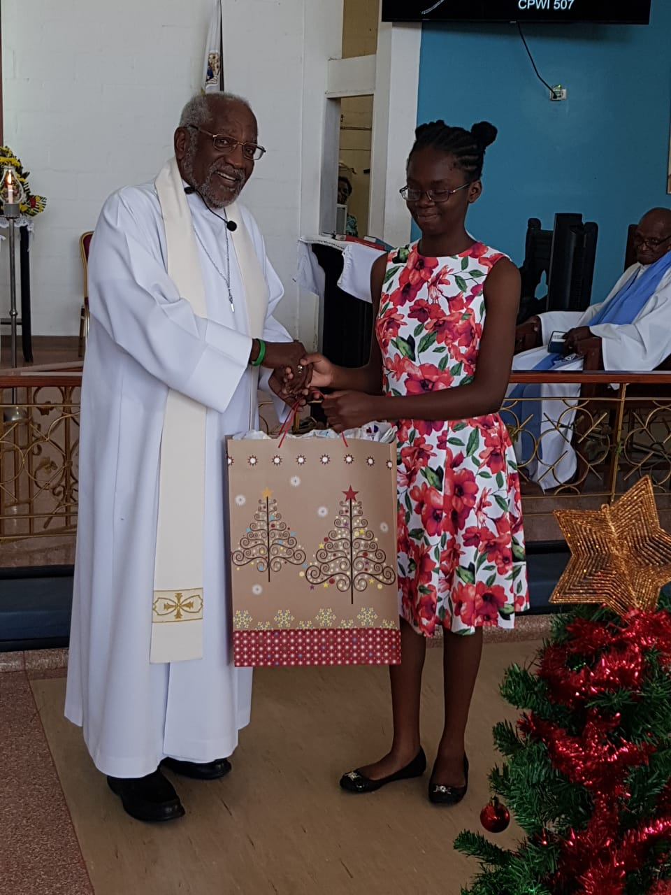 Canon West receiving his Christmas gift from La Shawn Roberts